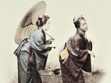 Two women with umbrella