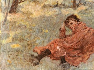 Young girl resting on grass