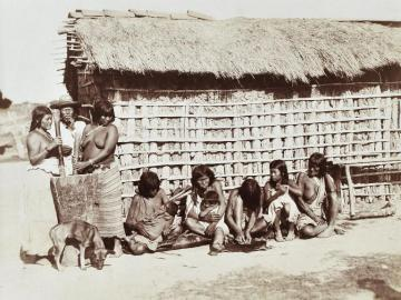 Indians in front of their house, Amazonia, Brazil