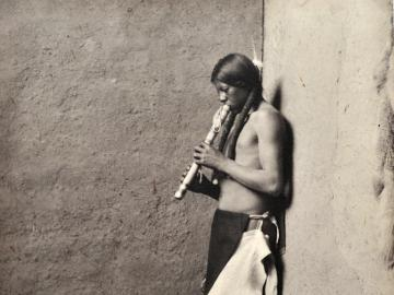 Navajo Indian playing flute